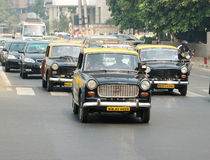 Mumbai traffic with several classical ambassador cabs,India royalty free stock photography