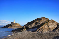 The Mumbles with it`s lighthouse at Swansea Bay Stock Photos