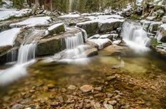Mumlava river with small waterfalls, Czech Republic. Winter picture of Mumlava river with small waterfall, Czech Republic Stock Photos