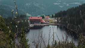 Mummelsee scenery hotel with lake royalty free stock photo