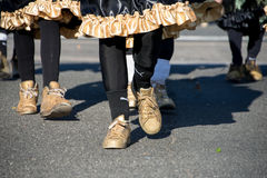Mummers march in a parade with gold shoes royalty free stock photos