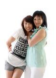 Mummia e figlia che hanno divertimento Immagini Stock