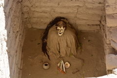 Mummified body at the Cemetery of Chauchilla, in the desert of Nazca, Peru Royalty Free Stock Photo