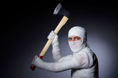 Mummy with axe Royalty Free Stock Photo
