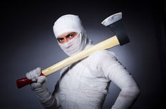 Mummy with axe i Royalty Free Stock Image