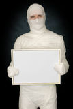 Mummy with blank frame Stock Images