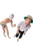 Mummy chasing archeologist. Evil mummy catching archeologist isolated on white royalty free stock image