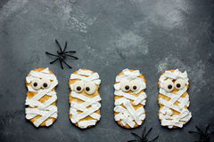 Mummy cookies for Halloween party. Thematic background on Hallow. Een. Creative food idea for kids Stock Photo