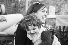 Mummy and daughter having fun. Black and white. Stock Photos