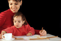 Mummy and daughter holding pencils Stock Photo