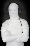 Mummy in ear-phones Royalty Free Stock Image