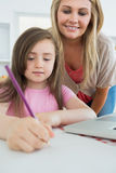 Mummy and her daughter coloring Stock Images