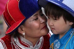 Mummy kisses son Stock Images