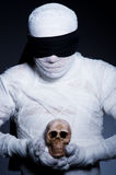 Mummy with skull Royalty Free Stock Image