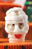 Mummy sweet on cup cake. Mummy sweet on an orange cup cake stock photo