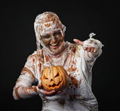The mummy is thumbup in the studio and smiling. The mummy is thumbup in the studio with pumpkin Stock Photography
