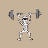 Mummy weight lifting Stock Image