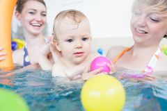 Mothers being happy about their babies playing with each other stock images