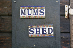 Mums Shed sign on door of garden shed royalty free stock photography