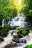Mun Dang Waterfall in deep forest fresh green rain season in Tha Stock Photos