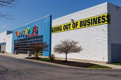 Muncie - Circa April 2018: Toys `R` Us Retail Strip Mall Location. Toys `R` Us is going out of business after filing bankruptcy I stock photos
