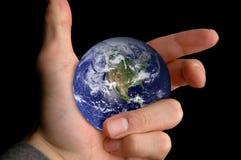 Mundo à mão imagens de stock