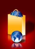 Mundo dentro de un bolso de compras Imágenes de archivo libres de regalías