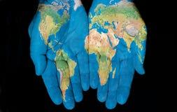 Mundo em nossas mãos imagem de stock royalty free