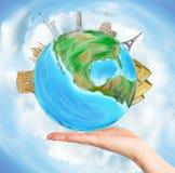 Mundo em uma mão Fotografia de Stock Royalty Free