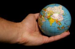 Mundo en la palma de su mano Imagen de archivo libre de regalías