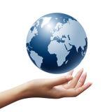 Mundo en su mano Imagen de archivo libre de regalías
