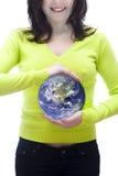 Mundo en sus manos Foto de archivo libre de regalías