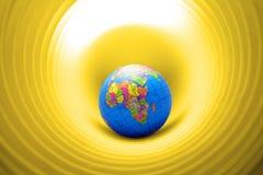 Mundo en un agujero imagen de archivo libre de regalías