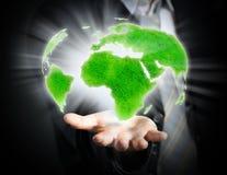 Mundo en una mano Imagen de archivo libre de regalías