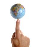 Mundo en una extremidad del dedo Fotografía de archivo libre de regalías