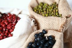 Mung bean ,Red soy beans and black soy beans In the cloth belt. Mung bean red soy beans and black soy beans In the cloth belt royalty free stock photo