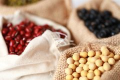 Mung bean ,Red soy beans and black soy beans In the cloth belt. Mung bean red soy beans and black soy beans In the cloth belt Sack stock images