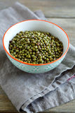 Mung Bean in a bowl on linen napkin Royalty Free Stock Photography