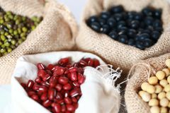 Mung bean ,Red soy beans and black soy beans In the cloth belt. Mung bean red soy beans and black soy beans In the cloth belt Sack stock photo
