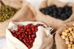 Mung bean ,Red soy beans and black soy beans In the cloth belt. Mung bean red soy beans and black soy beans In the cloth belt Sack stock image