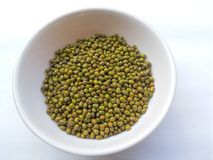 Mung beans in bowl on white background Royalty Free Stock Images