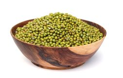 Mung beans. Heap of raw mungbeans is in wooden blow Stock Photo