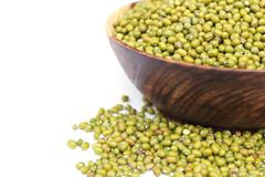Mung beans. Heap of raw mungbeans is in wooden blow Royalty Free Stock Images