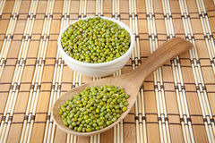 Mung beans over wooden spoon Stock Photos
