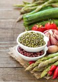 Mung beans and spoon Stock Images