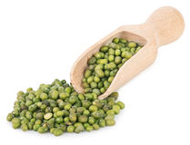 Mung beans in wooden scoop isolated on white background Royalty Free Stock Photo