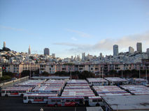 MUNI Bus Depot and Cityscape at dusk Stock Images