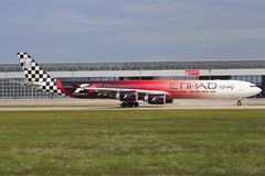 Formula 1. Munic/Germany August 9, 2014: Airbus 340-600 from Etihad Airways with Formula 1 special livery, ready to take off to Abu Dhabi Stock Photo
