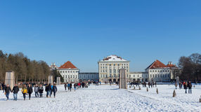 MUNICH – JANUARY 28: Beautiful view of Nymphenburg Palace in win. Ter with snow, in Munich, Bavaria Stock Image
