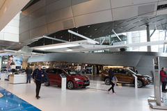 MUNICH – JANUARY 30: BMW Welt, Munich, Germany. People looking to buy a new car Stock Photography